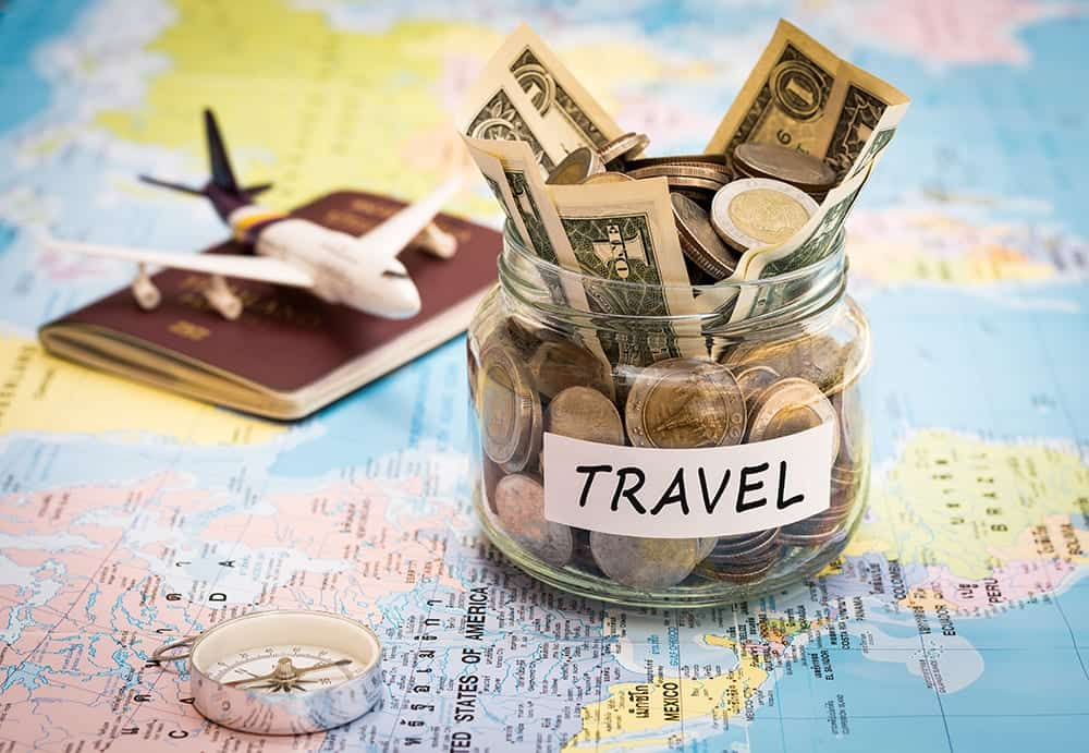 how to save money on holidays abroad